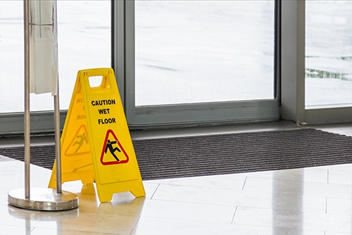 Yellow-Caution-slippery-wet-floor-sign-on-background